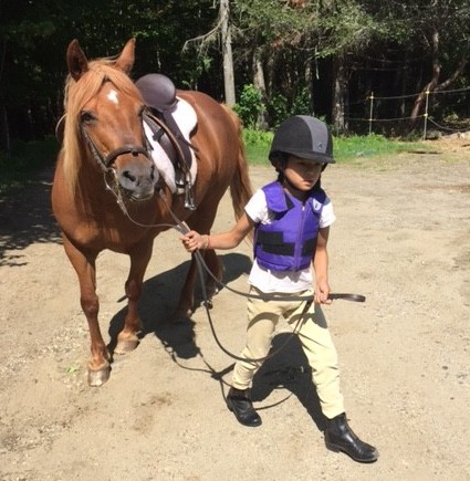 Maple with a determined child rider.